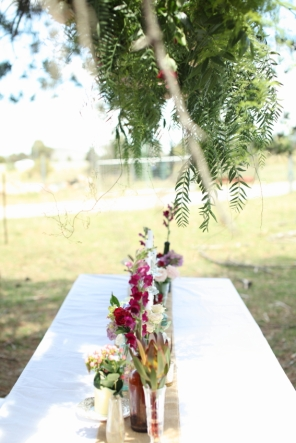 floral-table-setting-overhanging-flowers-tuli-king-photograhy-hippie-wedding-natural-wedding-canberra